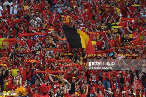 Belgium supporters cheer for their team before the UEFA EURO 2020 quarter-final football match between Belgium and Italy at the Allianz Arena in...