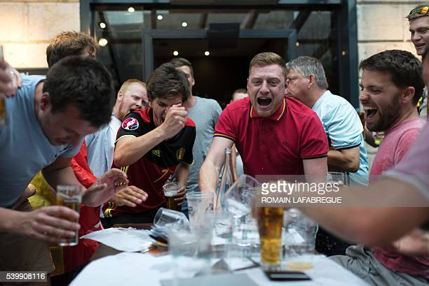 Belgium supporters drink beer in a pub next to the Lyon fan zone before the Euro 2016 football tournament match between Belgium and Italy on June 13...