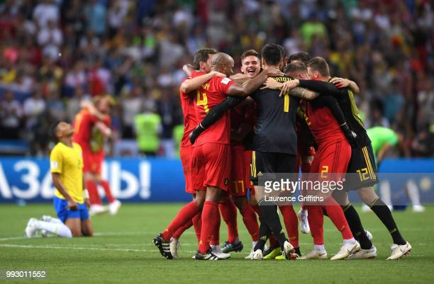 Belgium team celebrate their victory following the 2018 FIFA World Cup Russia Quarter Final match between Brazil and Belgium at Kazan Arena on July 6...