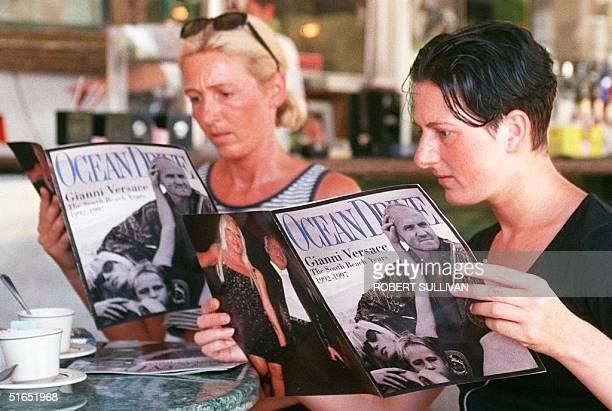 Belgium tourists Anja and Myriam Geelen look through a special issue of Ocean Drive magazine 23 July dedicated to slain Italian designer Gianni...