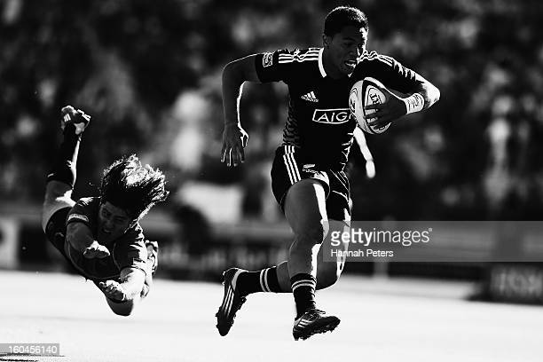 Belgium Tuatagaloa of the All Blacks Sevens makes a break during the Pool A match between New Zealand and Portugal during the 2013 Wellington Sevens...