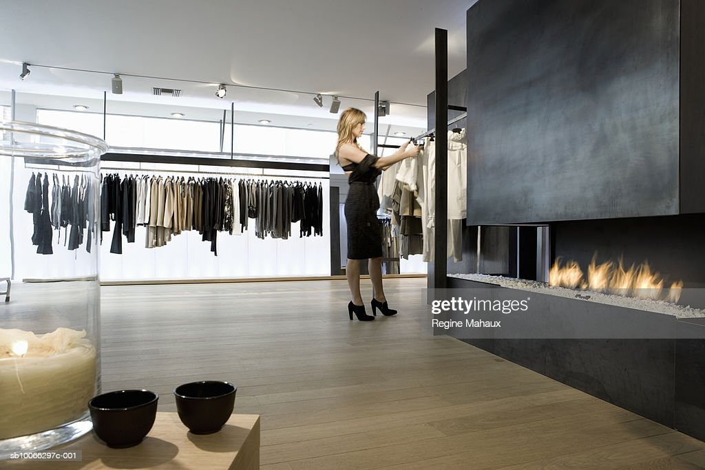 Belgium, woman looking at clothes in shop : Stock Photo