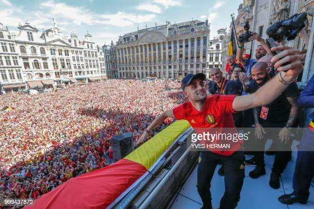 Belgium's Adnan Januzaj Belgium's head coach Roberto Martinez and Belgium's assistant coach Thierry Henry celebrate on the balcony in front of more...