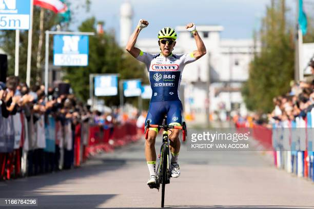 Belgium's Aime De Gendt of WantyGobert cycling team celebrates after winning the 'Antwerp Port Epic' cycling race of 1872km in and around Antwerp on...