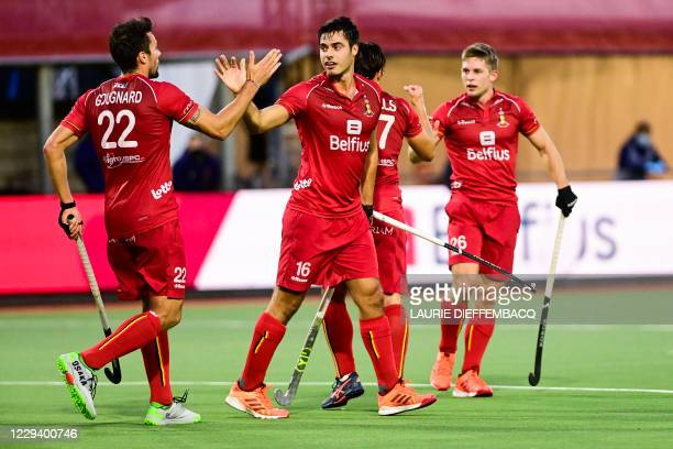 Belgium's Alexander Hendrickx celebrates with his teammates after scoring during a hockey game between the Belgian Red Lions and Great Britain's...