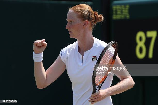 Belgium's Alison van Uytvanck celebrates a point against Estonia's Anett Kontaveit in their women's singles third round match on the sixth day of the...