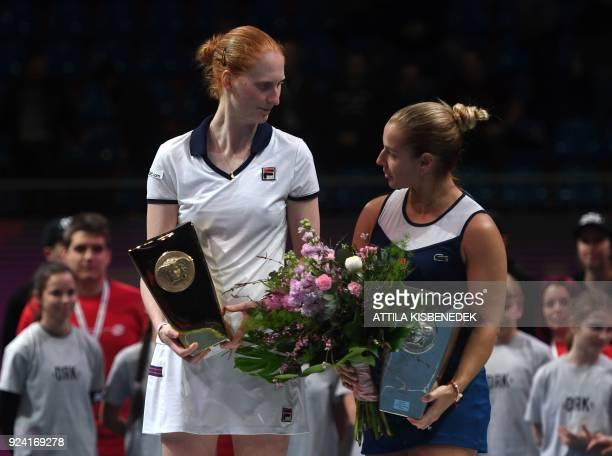 Belgium's Alison Van Uytvanck celebrates with her opponent Slovakia's Dominika Cibulkova after their final of the WTA Hungarian Open Ladies' tennis...
