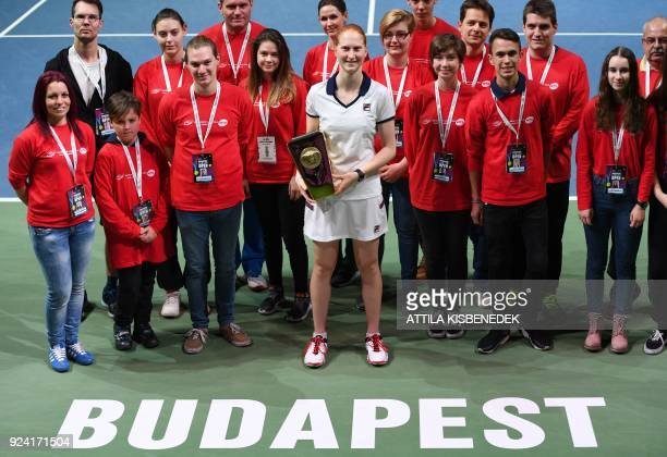 Belgium's Alison Van Uytvanck celebrates with her trophy and volunteers after she won her final match of the WTA Hungarian Open Ladies' tennis...