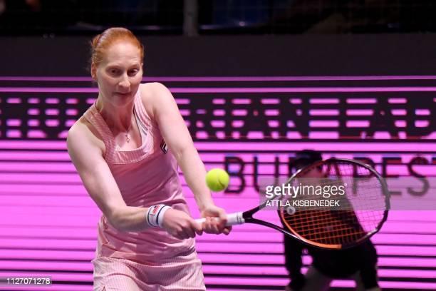Belgium's Alison Van Uytvanck returns the ball to Czech Republic's Marketa Vondrousova during their final match at the WTA Hungarian Open Ladies'...