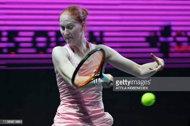 Belgium's Alison Van Uytvanck returns the ball to Russia's Ekaterina Alexandrova during their semifinal tennis match at the WTA Hungarian Open...