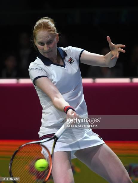 Belgium's Alison Van Uytvanck returns the ball to Slovakia's Dominika Cibulkova during their final match of the WTA Hungarian Open Ladies' tennis...
