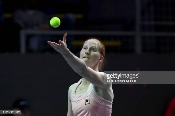 Belgium's Alison Van Uytvanck serves the ball to Russia's Ekaterina Alexandrova during their semifinal tennis match at the WTA Hungarian Open Ladies'...