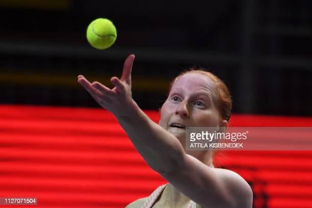 Belgium's Alison Van Uytvanck serves to Czech Republic's Marketa Vondrousova during their final match at the WTA Hungarian Open Ladies' tennis...