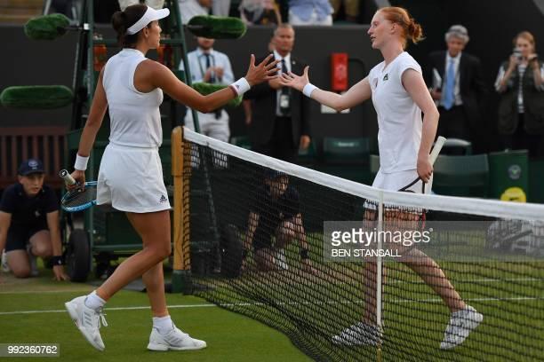 Belgium's Alison Van Uytvanck shakes hands after winning against Spain's Garbine Muguruza during their women's singles second round match on the...