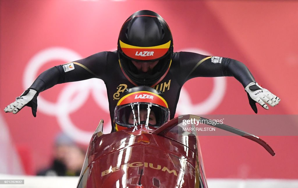 TOPSHOT - Belgium's An Vannieuwenhuyse and Belgium's Sophie Vercruyssen compete in the women's bobsleigh heat 1 run during the Pyeongchang 2018 Winter Olympic Games, at the Olympic Sliding Centre on February 20, 2018 in Pyeongchang. / AFP PHOTO / Mark Ralston