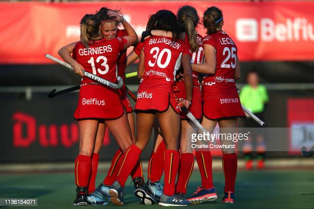 Belgiums AnneSophie Weyns celebrates with team mates after scoring the first goal of the game during the Women's FIH Field Hockey Pro League match...