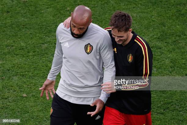 Belgium's assistant coach Thierry Henry and Belgium's forward Adnan Januzaj speak prior to the Russia 2018 World Cup semifinal football match between...