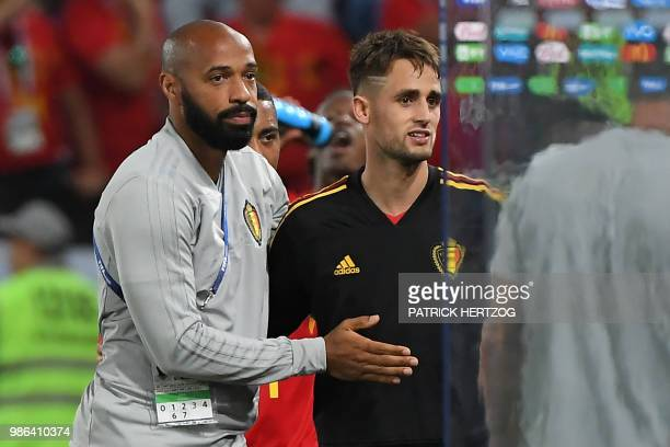 Belgium's assistant coach Thierry Henry congratulates Belgium's forward Adnan Januzaj at the end of the Russia 2018 World Cup Group G football match...