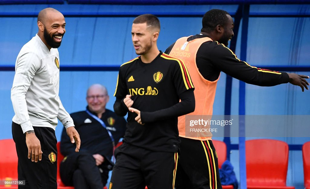 Belgium's assistant coach Thierry Henry (L) jokes with Belgium's forward Romelu Lukaku (R), as Belgium's forward Eden Hazard walks past during a training session at the Guchkovo Stadium in Dedovsk, outside Moscow, on July 9, 2018, on the eve of their Russia 2018 World Cup semi-final football match against France.