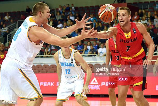 Belgium's Axel Hervelle vies for the ball with Ukrain's Kyrylo Fesenko during the Eurobasket 2015 group D basketball match Ukraine vs Belgium in Riga...