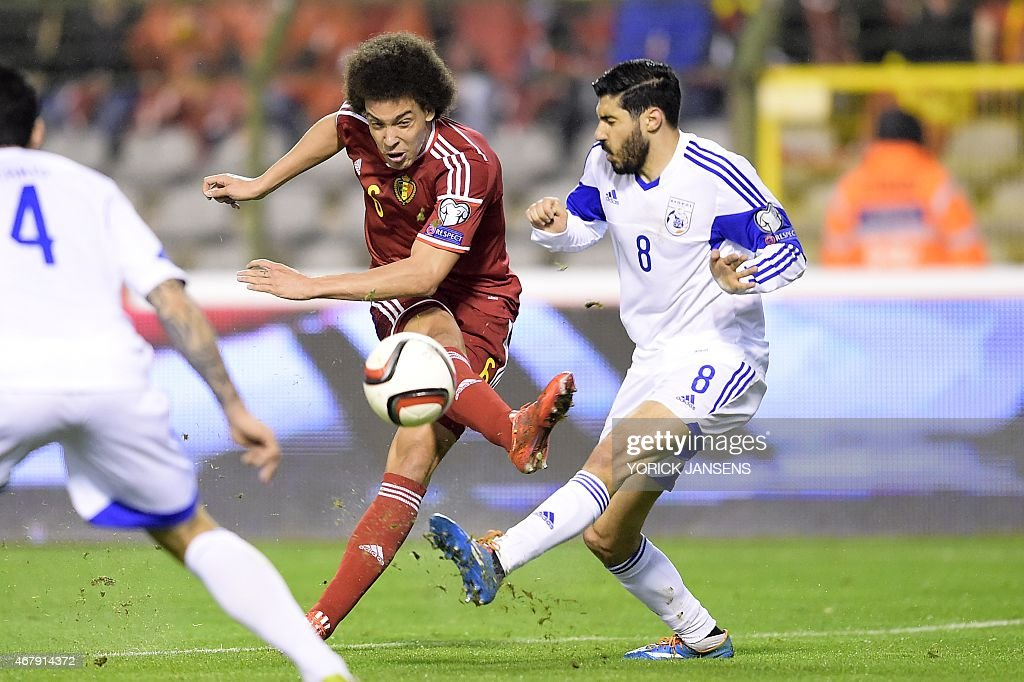 Belgium's Axel Witsel (L) vies with Cyprus' Charis Kyriakou during the Euro 2016 qualifying round football match between Belgium and Cyprus at the King Baudouin stadium in Brussels on March 28, 2015.