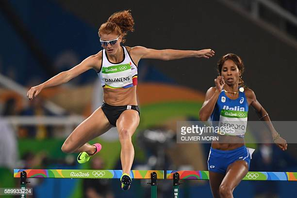 Belgium's Axelle Dauwens and Italy's Yadisleidy Pedroso compete in the Women's 400m Hurdles Round 1 during the athletics event at the Rio 2016...