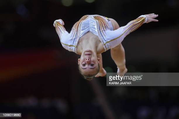 TOPSHOT Belgium's Axelle Klinckaert competes in the women's allaround final of the 2018 FIG Artistic Gymnastics Championships at the Aspire Dome on...