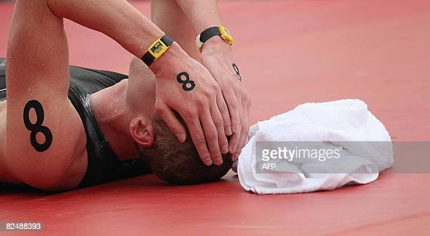 Belgium's Brian Ryckeman reacts after finishing the Men's Swimming 10 km marathon final of the 2008 Beijing Olympic Games at the Shunyi Rowing and...
