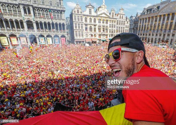 Belgium's captain Eden Hazard celebrates at the Grand Place/Grote Markt in Brussels city center as Belgian national football team Red Devils arrive...