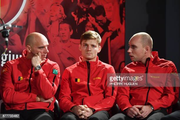 Belgium's captain Johan Van Herck sits next to his players David Goffin and Steve Darcis during the team presentation in Villeneuve-d'Ascq on...