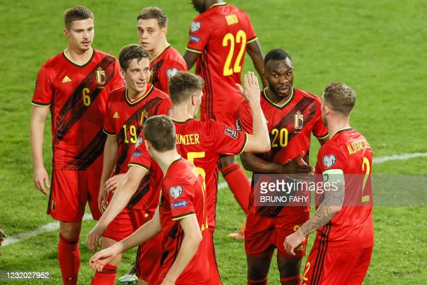 Belgium's Christian Benteke celebrates after scoring during a qualification game for the World Cup 2022 in the group E between the Belgian national...