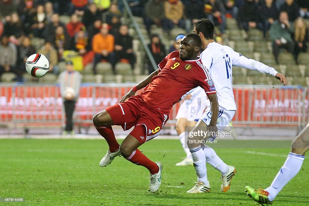 Belgium's Christian Benteke (L) vies with and Cyprus' Constantinos Laifis during the Euro 2016 qualifying round football match between Belgium and Cyprus at the King Baudouin stadium in Brussels on March 28, 2015.