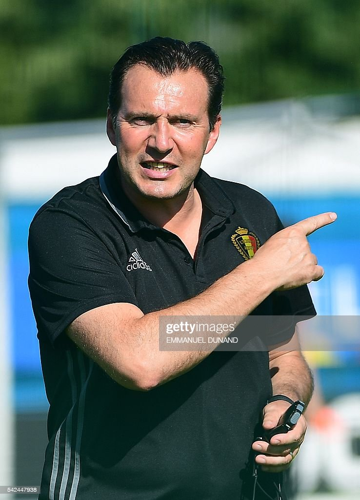 Belgium's coach Marc Wilmots attends a training session for the alternate players in Le Haillan during the Euro 2016 football tournament on June 23, 2016. / AFP / EMMANUEL