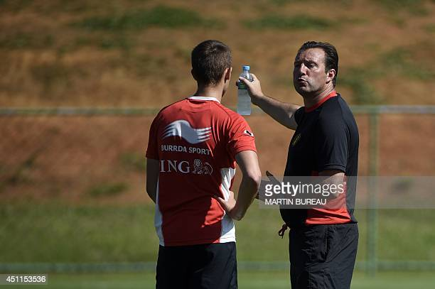 Belgium's coach Marc Wilmots speaks to Belgium's midfielder Adnan Januzaj during a team training session in Mogi das Cruzes on June 24 during the...