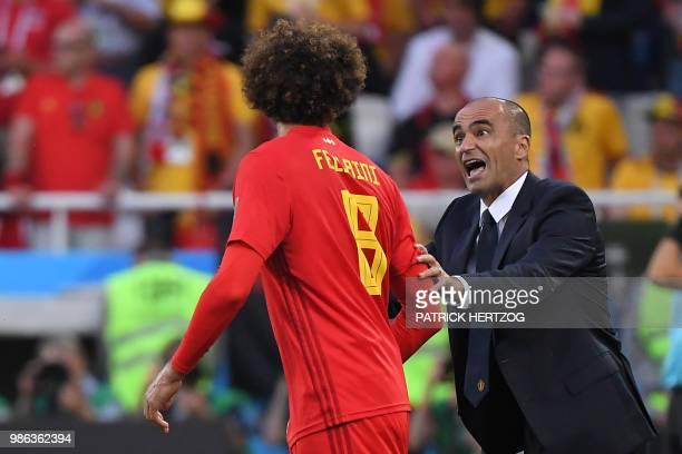Belgium's coach Roberto Martinez talks to Belgium's midfielder Marouane Fellaini during the Russia 2018 World Cup Group G football match between...