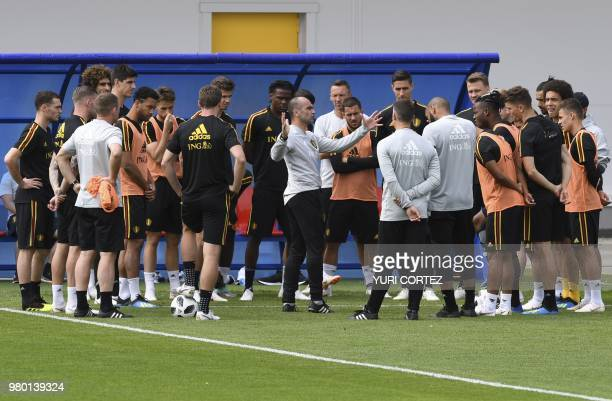 Belgium's coach Roberto Martinez talks to his players during a training session at the Guchkovo Stadium in Dedovsk outside Moscow on June 21 during...