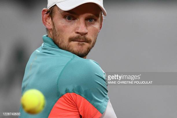 Belgium's David Goffin eyes the ball as he returns the ball to Italy's Jannik Sinner during their men's singles first round tennis match on Day 1 of...
