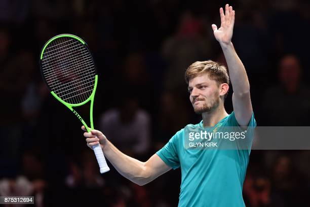 Belgium's David Goffin gestures to the crowd after his straight sets win over Austria's Dominic Thiem in their men's singles roundrobin match on day...
