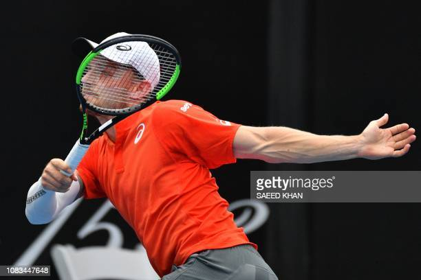 Belgium's David Goffin hits a return against Romania's Marius Copil during their men's singles match on day four of the Australian Open tennis...