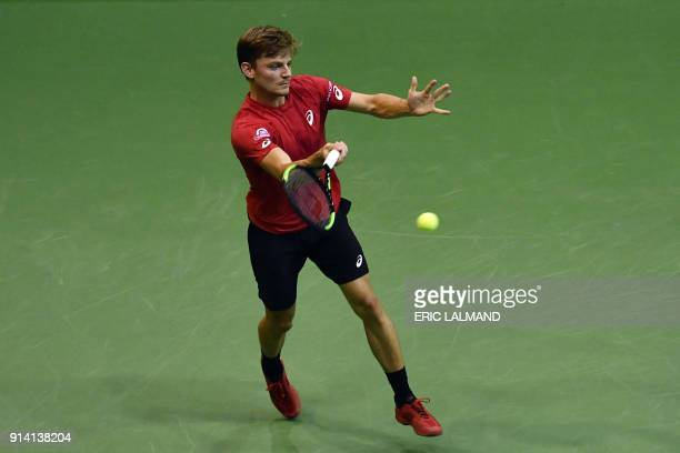 Belgium's David Goffin hits a return to Hungary's Marton Fucsovics during their tennis match as part of the Davic Cup World group tie between Belgium...