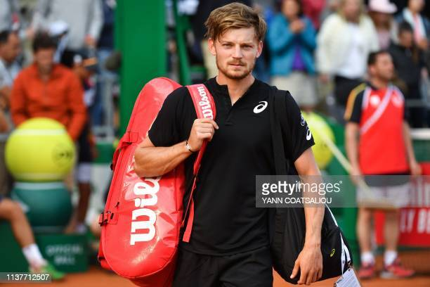 Belgium's David Goffin leaves the court following his defeat against Serbia's Dusan Lajovic at the end of their tennis match on the day 5 of the...