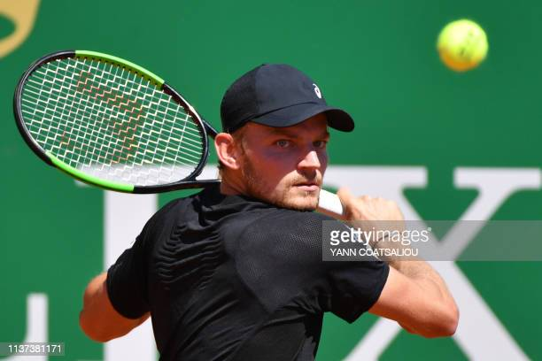 Belgium's David Goffin plays a backhand return to Argentina's Guido Andreozzi during their tennis match on the day 3 of the Monte-Carlo ATP Masters...