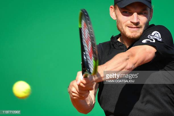Belgium's David Goffin plays a backhand return to Serbia's Dusan Lajovic during their tennis match on the day 5 of the MonteCarlo ATP Masters Series...