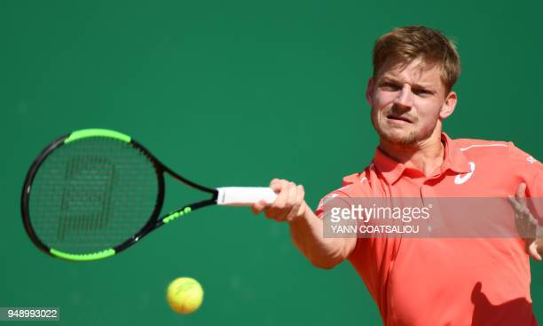 Belgium's David Goffin plays a forehand return to Bulgaria's Grigor Dimitrov during their singles tennis match at the MonteCarlo ATP Masters Series...
