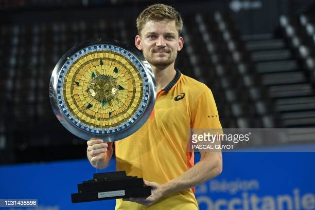Belgium's David Goffin poses with his trophy after he won the final of the ATP World Tour Open Sud de France tennis tournament in Montpellier on...