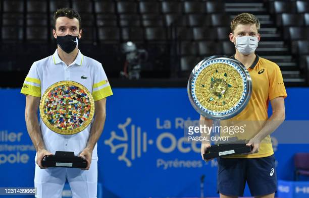 Belgium's David Goffin poses with his trophy after winning the final of the ATP World Tour Open Sud de France tennis tournament against Spain's...
