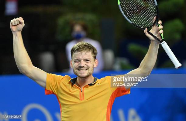 Belgium's David Goffin raises his arms in victory as he wins the final of the ATP World Tour Open Sud de France tennis tournament against Spain's...