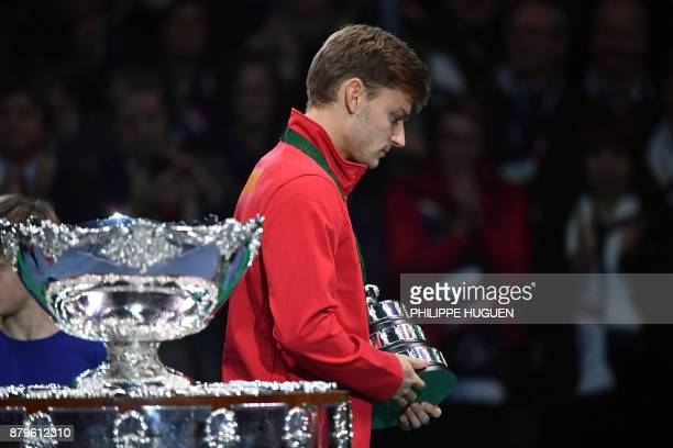 Belgium's David Goffin reacts after the Davis Cup World Group final tennis match between France and Belgium at The Pierre Mauroy Stadium in...