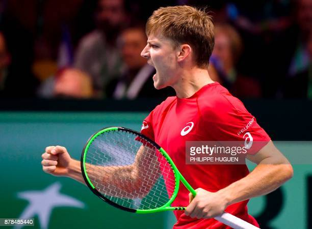 Belgium's David Goffin reacts after winning a match against France's Lucas Pouille during the Davis Cup World Group singles rubber final tennis match...