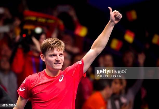 Belgium's David Goffin reacts after winning a match against France's Lucas Pouille during the Davis Cup World Group singles rubber final tennis match...